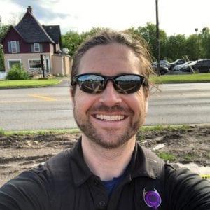 Derek smiling wearing sunglasses