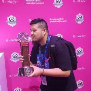 Jon V kissing a trophy